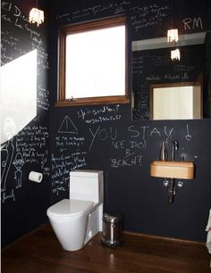 Great idea for powder room. This blackboard wall will keep the laughs coming.