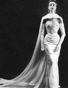 An evening gown and cape by Pierre Balmain in a 1953 photo by Willy Maywald
