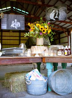 BBQ Barbecue Wedding Rehearsal Dinner. engagement photos were blown up at kinkos in poster size.  we used spray adhesive to mount them onto plywood.  and then they were hung from the rafters in the barn.