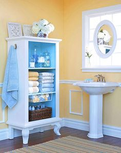 This is an ideal solution to my closet-less bathroom! I like the idea of using shelf-brackets to separate the towels, LOVE the apothecary-jar storage for my bath goodies, and the basket full of shampoos & goodies is perfect too.