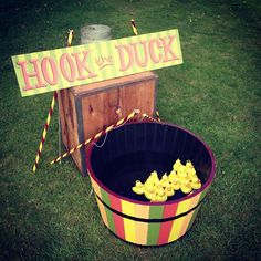 Use real fishing rods to hook little ducks floating round a large half-barrel of water. The barrel is painted in bright fairground colours and lined with waterproof sealant. Also included is a 'hook-the-duck' ground sign to match the paintwork on the barrel.