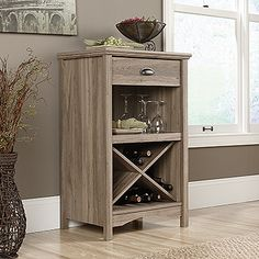 Drawer features metal runners and safety stops. Criss-cross rack storage. Quick and easy assembly with patented T-lock drawer system. Salt Oak finish.