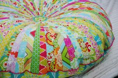 Floor pillow made with a jelly roll of fabric.
