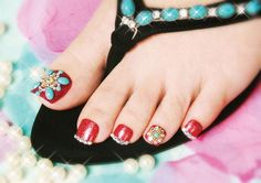 Jeweled red pedicure from INSPIRE | Bead, rhinestone nail art | Glamorous Nails | Boho Nails | Summer Pedicures | Elegant, Detailed nail trend | Indian nail art | Nailpro Magazine