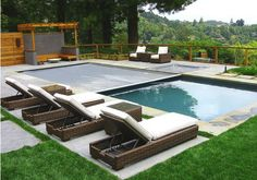 rectangular pool with boxwoods | Add an Automatic Pool Cover