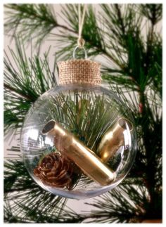 Glass like plastic ornament, filled with real pine cones, once fired polished .308 bullet casings, and artificial pine. Handmade item. Contact me for custom orders
