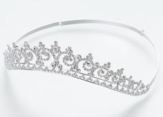 Rhinestone Bridal Tiara    Item #: JL200 14    This large bridal tiara features an ornate arrangement of rhinestones. Every bride feels like she is queen for a day, and any bride will look simply majestic wearing this stunning tiara. Available in silver only.    List Price:   $58.00  Our Price:   $49.90
