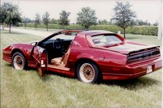 Nice #Ferrari back on this Pontiac Trans Am  From 1988. This is a rear view of our CEOJeff Ostroff's new flame red metallic Pontiac Firebird TransAm GTA, with custom Ferrari Back.  #Firebird #TransAm #GTA  #throwbackthursday . #TBT #tbthursday