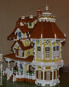 This Victorian House is quilled!  Kudos to the quiller!  Absolutely amazing, seriously.