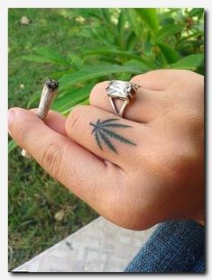 Cute Weed Plant Tattoos For Girls Cannabis leaf finger tattoo Dope Tattoos, Hand Tattoos, Trendy Tattoos, Leaf Tattoos, Body Art Tattoos, Small Tattoos, Tattoos For Guys, Tattoos For Women, Tribal Tattoos