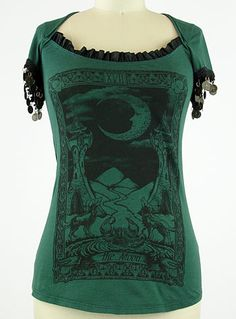"""This incredible Gypsy Nights tee, from Lip Service, features a gorgeous deep forest green colored body with a spooky black """"The Moon"""" Tarot card print on the front, and metal coin fringe accents on the sleeves that jingle"""