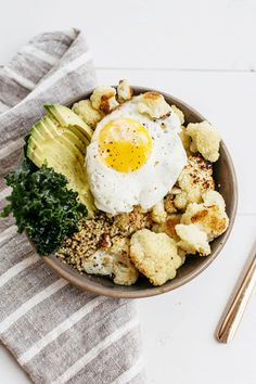 Poached egg, kale, avocado, cauliflower, quinoa bowl