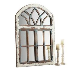 We're fans of a mirror with character—particularly one with an antiqued blue finish. Carefully placed, our handcrafted mirror will create an illusion of surprise passageways with its casement framing topped by a faux fan transom. Garden Mirrors, Garden Windows, Arch Windows, Home Decor Kitchen, Diy Home Decor, Kitchen Paint, Kitchen Ideas, Faux Window, Tuscan Decorating