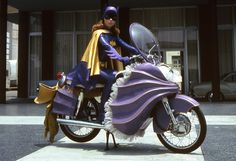 Batgirl on her frilly batcycle