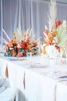 Take a look at this sweet orange-themed boho baby shower! The floral arrangements are so pretty! See more party ideas and share yours at CatchMyParty.com