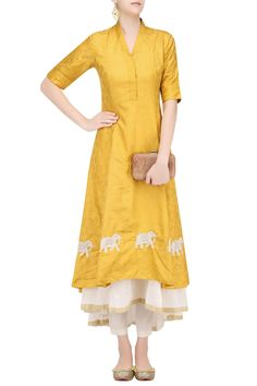 Description Featuring a yellow double layer flared khadi dress with stand collar and elephants embroidered motifs around the hem. It is paired with white straight pants. FIT: Fitted at bust and waist. COMPOSITION: Khadi.