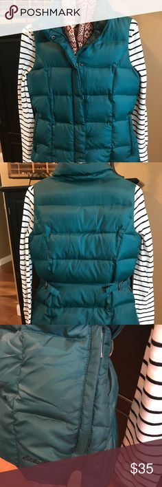 Eddie Bauer Down Vest Beautiful turquoise colored Eddie Bauer goose down vest. Size extra small. Like new! Eddie Bauer Jackets & Coats Vests