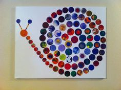 Kids painted on paper and was cut into circles, arranged like a snail and modge podged onto canvas.