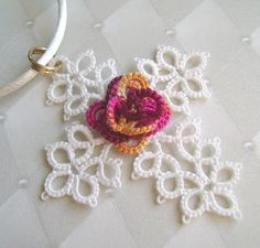 """""""Eternal Rose Cross."""" Marilee Rockley teaches beginner & advance TATTING. You can find this FREE pattern and download it at Craftsy. Should be fairly straightforward. The rose center is all """"rings"""" and small """"picots"""" and the cross is rings, chains and picots. Just need basic supplies. One tatting shuttle, small crochet hook, Sz 20 thread and a sewing needle. Marilee's tatting classes at Craftsy.  Yarnplayer's Tatting Blog: """"Eternal"""" tatted cross with 3-D rose center ©️2009 Marilee Rockley"""