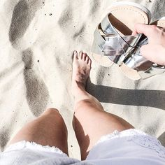 Outfit Inspiration: Forever New white denim shorts and Witchery silver metallic slides. Follow @jayde_archives on Instagram.