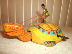 """1930s Chein 8"""" Tin Litho Wind Up Native on Turtle w Nice Detailing Color"""