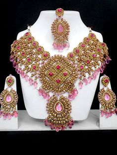 The Very Exclusive Indian Patwa Jewelry  sets available with matching pair of  earrings and mangtikka. The speciality of  this jewelry set is its gorgeous looks  which is beatifully handcrafted work with  high quality Cubic Zirconia (CZ) stones  and the beads of different size, color and  shape which makes its more lookrative.  This patwa jewelry set is also worn as  bridal jewelry or semi bridal jewelry.    visit us at www.impexfashions.com