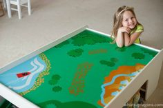 Playing with an empty train table. Turn into a Frozen playscape!