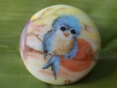 Check out this item in my Etsy shop https://www.etsy.com/listing/514283299/vintage-button-1-collector-adorable-blu