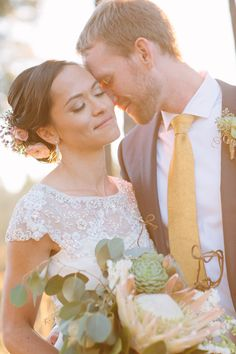 sweet moment between bride and groom on their wedding day