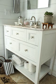 Basement Finishing Ideas: Open Bathroom Vanity With Baskets On Shelf For Storage