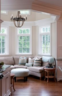 Cozy Breakfast Nook. Couch in the kitchen - I like that idea!
