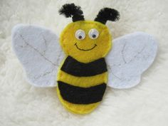 This cute and colourful bee brooch is bound to attract attention. It would brighten up any winter coat or look great with a summer floral outfit, or be a great bee lovers gift, bee keepers gift, nature lovers gift or a little treat for yourself. Gifts For Nature Lovers, Lovers Gift, Bee Brooch, Garden Gifts, Black Felt, Badges, Brooches, Wildlife, Handmade Items
