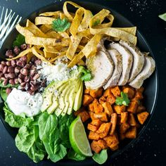 Intensely flavored enchilada bowl with pork chili verde, roasted sweet potatoes!  Topped with avocado and cotija!  So good.