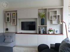 Added storage throughout the home, built in any style you like from floating to built in. Your fitted shelves in London are made specifically for your home. Media Wall, Modern Wardrobe, Wall Storage, Wardrobes, Modern Contemporary, Shelves, Home, Style, Swag