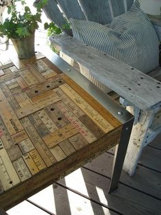 upcycled old table using vintage rulers . Think I will give this a try!