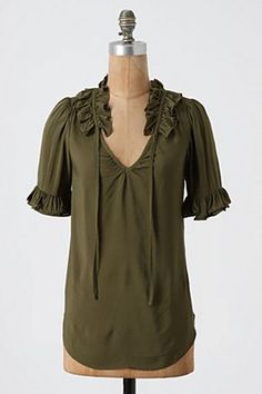 love the detail at the neck and the longer sleeve on this moss colored blouse...a steal @ $68.oo