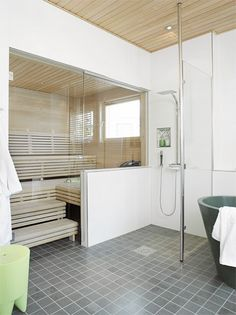 I know you would not have a sauna in your bathroom. but you can get the feel from the photo of painted walls, some wood detail on the ceiling and wall and nice calm tile on the floor. bright and airy Bathroom Spa, Bathroom Interior, Modern Bathroom, Small Bathroom, Dream Bathrooms, Beautiful Bathrooms, Basement Sauna, Sauna Shower, Shower Tub