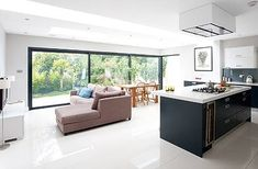 Desperate for extra space, Lucy and Russ Davies converted their loft, plus built an extension and converted their garage to create a stunning open-plan kitchen-diner Open Plan Kitchen Dining Living, Open Plan Kitchen Diner, Living Room Ideas Open Plan, Kitchen Family Rooms, Living Room Kitchen, Sofa In Kitchen, Living Room And Kitchen Together, Single Storey Extension, Rear Extension