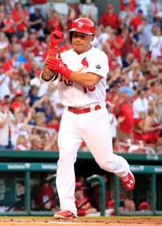 St. Louis Cardinals Team Photos - ESPN St. Louis Cardinals' Kolten Wong celebrates as he arrives at home after hitting a solo home run during the first inning of a baseball game against the Arizona Diamondbacks Wednesday, May 27, 2015, in St. Louis. (AP Photo/Jeff Roberson)