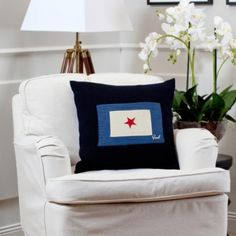 Patch knit wool cushion featuring flag patch and zipper closure.      Innercushion not included.