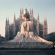 Christo and Jeanne-Claude, Wrapped Monument to Vittorio Emanuele II, Piazza del Duomo, Milano, Italy, 1970 - By wrapping them [the objects], he would reveal some of the most basic features and proportions of the object by concealing the actual item.
