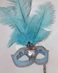 Stunning Silver  and Turquoise Feather by MasksandTiaras on Etsy