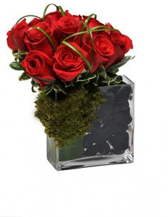 Red Hook | A modern and exquisite display of flawless red roses clustered with green moss and black river rocks.