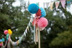 Pennant banner, tissue pom poms, paper daisies at Colorful Texas Wedding at Mercury Hall « Southern Weddings Magazine.