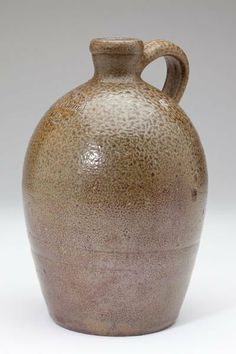 NC Pottery Jug, J.F. Brower Masonic Stamp salt glazed stoneware with large circular stamp and capacity mark (2 quarts), turned by Himer Fox (1848-1911). 9.5 in.