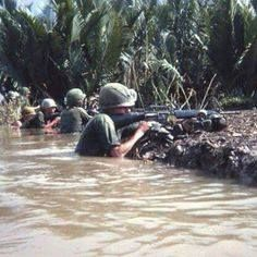 """The veteran stated this about his photo: """"Caught in midst of canal crossing, members of 3rd Plt. CoB 2/3 199th Light Inf. Bde. return fire. Mekong Delta, s/w of Saigon 1967."""" #Vietnam #War God awful conditions remind of trench warfare. How many arms didn't fire due to atmospheric conditions, etc. God bless them."""