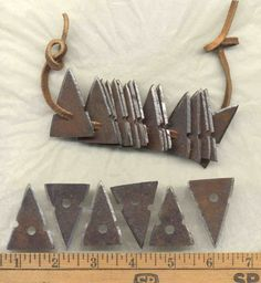 Simple trade arrowheads - based on a string of 25 found up in Maine. I cut/filed/ground these out of a wooden whiskey barrel band. The remains of the last quench tub.