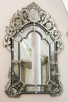 Venetian Mirror!   I must find a mirror like this.