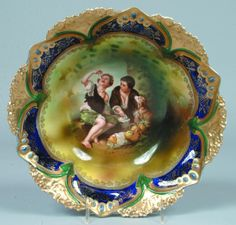 """RS Prussia Bowl """"Melon Eaters"""" figural design on mixed greens ground with shadow ivy and clouds, stenciled border, enameled domes with opalized jewels, cobalt fill in domes and green spears between Good China, Portrait Pictures, Prussia, Cobalt, Ivy, Objects, Porcelain, Clouds, Jewels"""