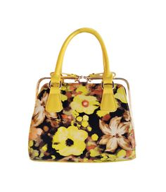 """Go a little retro with this bright, bold purse! We love the patent leather accent and the funky print. Opens with a sliding buckle bow. With removable strap! Pairs great with a simple white tee, skinny denim and booties or sneakers for a casually cool look!Approx. 9"""" wide X 8"""" tall X 6"""" high"""